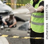Small photo of Image of policeman at car accident area