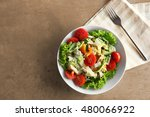 plate with fresh salad on gray... | Shutterstock . vector #480066922