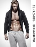 Small photo of Strong Athletic Man showing big biceps and abdominal muscles
