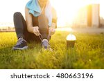 sporty runner woman tying laces ... | Shutterstock . vector #480663196
