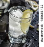 Small photo of Vodka, Tequila, GIN, vodka in a glass with ice, lime, a cocktail bar, alcohol, alcoholic beverage. Closeup