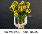 Girl Holding A Large Bouquet O...