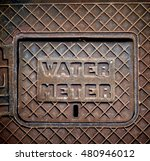 old rusted water meter cover on ... | Shutterstock . vector #480946012