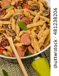 Small photo of Sausage Pasta Alfredo Dinner. Selective focus.