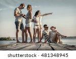 friends sitting on wooden pier... | Shutterstock . vector #481348945