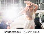 elegant woman hiding her face... | Shutterstock . vector #481444516