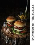 delicious burgers in a rustic... | Shutterstock . vector #481605166