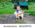 Small photo of smiling little boy affectionately embraces a red cat. outdoor
