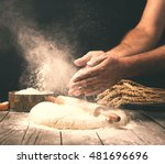 Man Preparing Bread Dough On...
