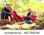 Family With Kids Having Picnic...