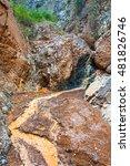 Small photo of Mountain orange river in the rocky shores of the Aeolian mountains, Kyrgyzstan.