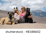 Woman sitting with dogs - stock photo