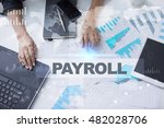 Small photo of Woman working with documents, Tablet pc and notebook. Payroll Concept.