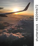 Small photo of wing of aeroplane and sunset in evening silhouette style