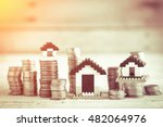 house models with stacked coins ...   Shutterstock . vector #482064976