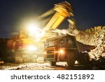 Small photo of Mining. excavator loading granite or ore into dump truck