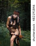 Small photo of Female american indian warrior in the forest