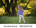 llittle girl playing in the park | Shutterstock . vector #482204416