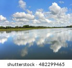 Reflection of sky and clouds causes you to see double, as the surface of the Yahara River serves as a mirror for the scenery, on the Yahara River Trail in Wisconsin.