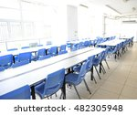Stock photo clean school cafeteria with many empty seats and tables 482305948