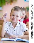 little schoolboy pulls his hand ... | Shutterstock . vector #482324272