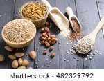 nuts and cereal seeds on black... | Shutterstock . vector #482329792