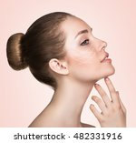 woman touching her face with... | Shutterstock . vector #482331916