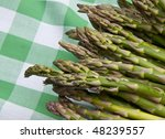 Fresh asparagus on a green picnic blanket.  Healthy Summer Eating. - stock photo