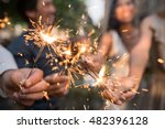hands of people holding glowing ... | Shutterstock . vector #482396128