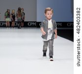 Small photo of Moscow, Russia August 31, 2016: International Fashion Trade Show, collections for spring-summer 2017, on the catwalk models present a new style children's collection for boys.