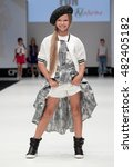Small photo of Moscow, Russia September 01, 2016: International Fashion Trade Show, collections for spring-summer 2017, on the catwalk models present a new style children's collection for girls.