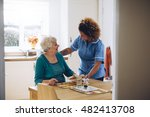 care worker giving an old lady... | Shutterstock . vector #482413708