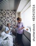 senior woman taking her... | Shutterstock . vector #482415016