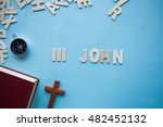 Small photo of Blue background with the Bible book of 3 John