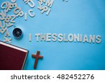 Small photo of Blue background with the Bible book of 1 Thessalonians