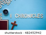 Small photo of Blue background with the Bible book of 1 Chronicles