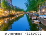 amsterdam. city canal at dawn. | Shutterstock . vector #482514772