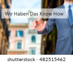 Small photo of Wir Haben Das Know How! (We Have the Know-How in German) - Businessman hand touch button on virtual screen interface. Business, technology concept. Stock Photo