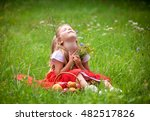 beautiful little girl picking... | Shutterstock . vector #482517826