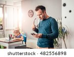 worried father looking at smart ... | Shutterstock . vector #482556898