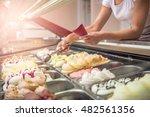 woman serving ice cream in... | Shutterstock . vector #482561356