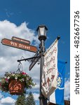 Small photo of Street sign in bavarian village of Leavenworth, Washington with flower pots and Alpen Strasse