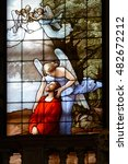Small photo of COMO, ITALY - CIRCA APRIL 2016 - The agony of Jesus Christ in the Olive mountain (Getsemane garden), comforted by an angel. A detail of a stained glass window in the cathedral.
