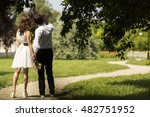 couple holding hands on park... | Shutterstock . vector #482751952