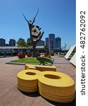 """Small photo of 2015 December 17, Melbourne Australia - Iconic sculpture """"Cow up a Tree"""" by John Kelly in Docklands section in Melbourne. 8-metre high, four ton bronze sculpture originally installed in February 2001."""