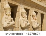 """Three ancient statues at the temple """"Hatschepsut"""" at Luxor in Egypt - stock photo"""