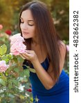 Stock photo beautiful woman in garden with roses gardening 482862382