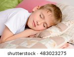 the boy sleeping on the bed in... | Shutterstock . vector #483023275