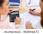 two female accountants counting ... | Shutterstock . vector #483046672