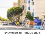 Small photo of LOS ANGELES,CALIFORNIA,USA, JULY-13,16: a lot of homeless tents on the walkway in the urban,Los Angeles,usa. -blurred.
